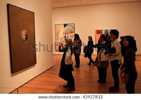 NEW YORK, US - DEC. 09: People taking picture of famous painting representing Marylin Monroe at Moma Museum December 09, 2009 in New York, US.