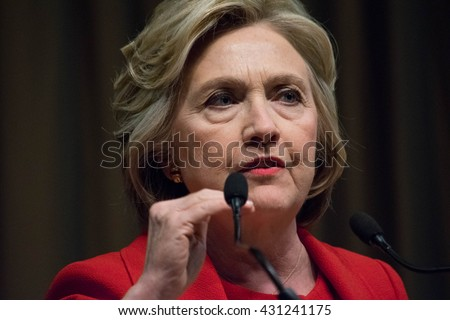 NEW YORK, USA - APRIL 13, 2016: Hillary Clinton dressed in a red suit addresses the National Action Network 25th annual convention.