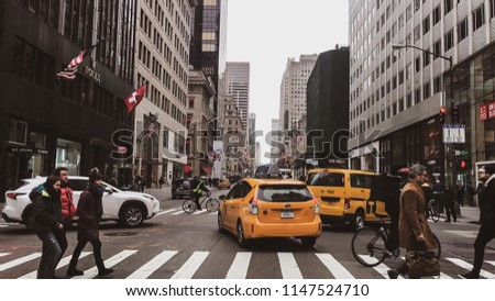 New York, USA - April 18, 2017: Streets of New York City - New York is also the most densely populated major city in the United States. With an estimated 2015 population of 8.5 million #1147524710