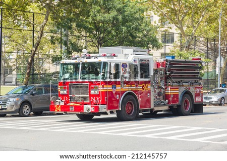 NEW YORK, USA - AUGUST 20, 2014: FDNY fire truck on Manhattan 9th Avenue. FDNY provide both Fire and EMS services.