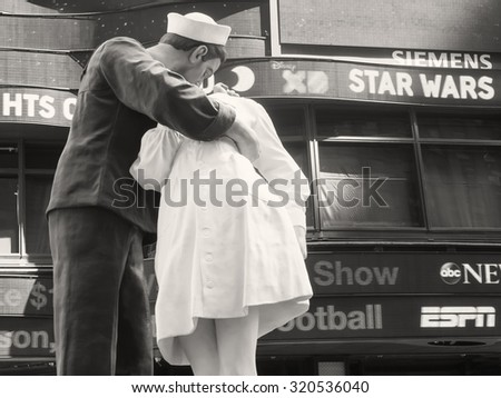 Sailor kissing girl in times square