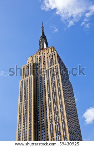 NEW YORK, USA - JULY 7: Facade of Empire State Building in the afternoon with iron statue of Man on the roof on July 7,2010 in New York, USA.