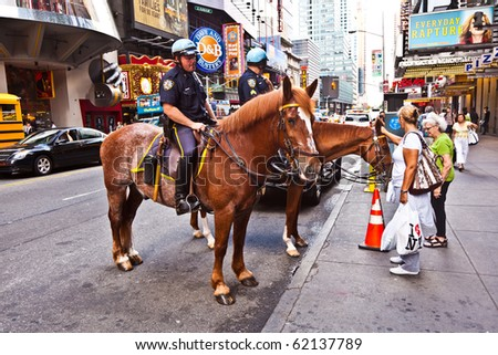 NEW YORK, USA - JULY 7: police officers ride their horses downtown in New York on the main street, Manhattan on  July 7,2010, New York, USA