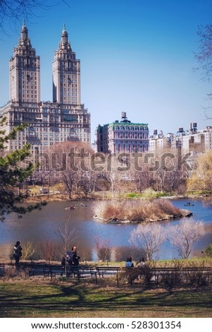 NEW YORK, USA - MARCH 26: Unknown people in the central park. The central park is one of the largest parks in the USA and the most known in the world on March 26, 2014 in New York, USA #528301354