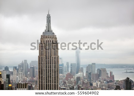 NEW YORK, USA - May 03, 2016: New York skyline. Aerial view over Manhattan with Empire State Building and World Trade Center. Manhattan is the most densely populated of the five boroughs of NYC