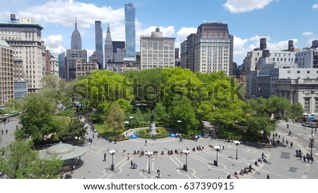 New York, USA - May 09, 2017 - Union Square park with New York skyline and people #637390915
