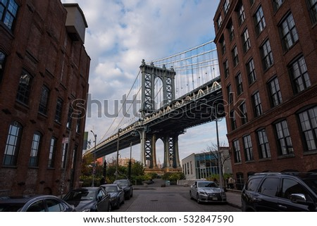 New York, USA - November 17, 2016 : Manhattan Bridge view from Dumbo, Yew York City.  New York City is the most populous city in the United States of America.    #532847590