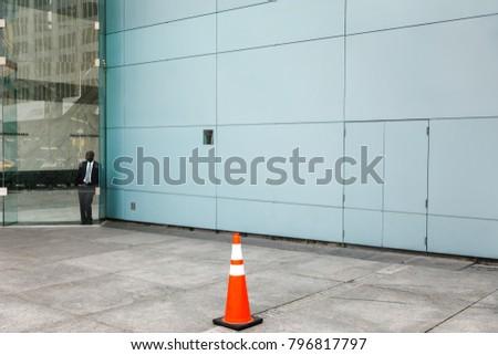NEW YORK, USA - Sep 17, 2017: Manhattan street scene. Black man stands behind a glass door. #796817797
