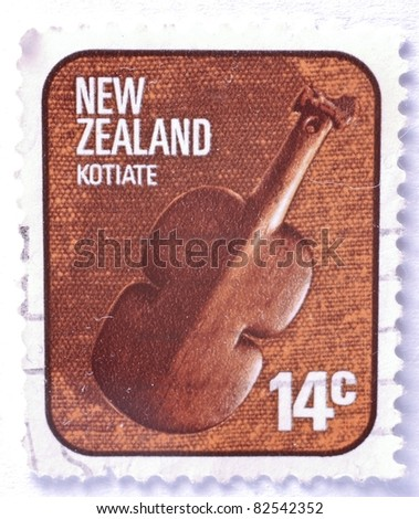 NEW ZEALAND - CIRCA 1976: a 14 cent stamp from New Zealand (catalogue number Scott 2008 614) shows image of a kotiate, a violin shaped weapon, circa 1976