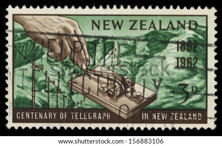 NEW ZEALAND - CIRCA 1962: A stamp printed in New Zealand honoring Centenary of the telegraph service in New Zealand, shows a hand operating an early morse key, circa 1962