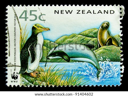 NEW ZEALAND - CIRCA 1991: A stamp printed in New Zealand, shows a yellow-eyed penguin, dolphin  circa 1991