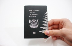 New Zealand passport in hand