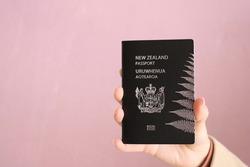 New Zealand passport in hand