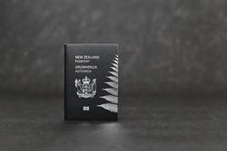 New Zealand passport on black background