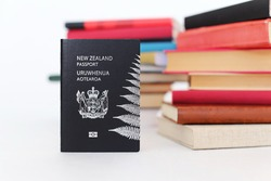 New Zealand passport on the table with books