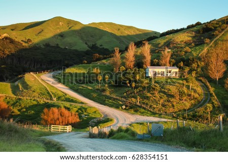 New Zealand rural road, house, and farm land
