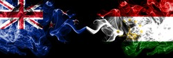 New Zealand vs Tajikistan, Tajikistani smoky mystic flags placed side by side. Thick colored silky abstract smoke flags