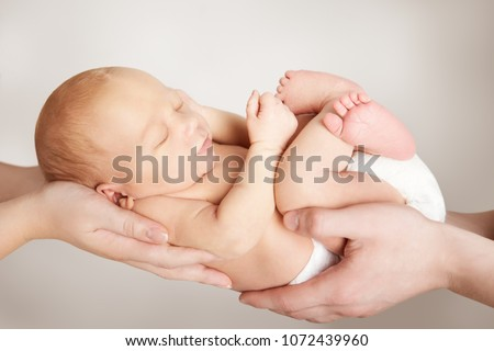 Newborn Baby and Family Concept, Parents Couple Holding New Born Child in Hands, Mother Father Hold Infant Kid