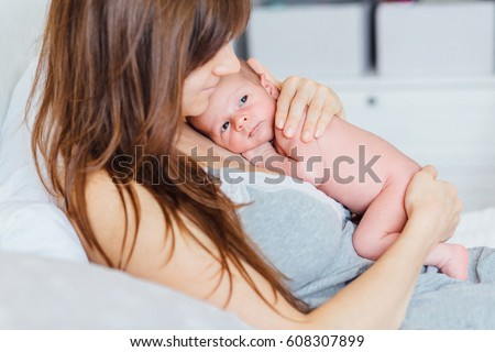 newborn baby and mother. Beautiful conceptual image of Maternity. #608307899
