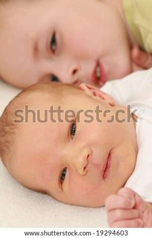 newborn baby and 5 years old brother