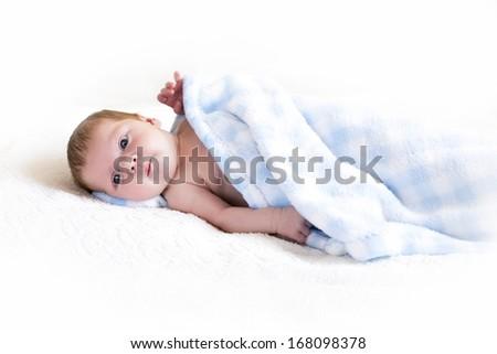 newborn baby baby under a blanket