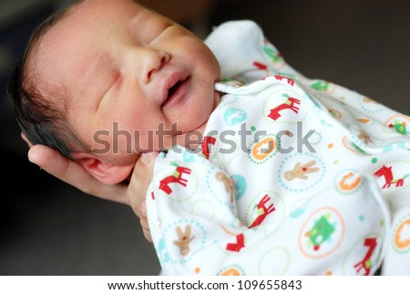 newborn baby boy on the father's hand