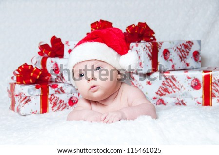 Newborn baby boy Santa Claus with Christmas gifts