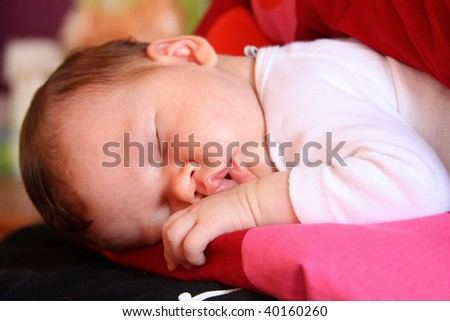 Newborn baby child getting some rest on pillow