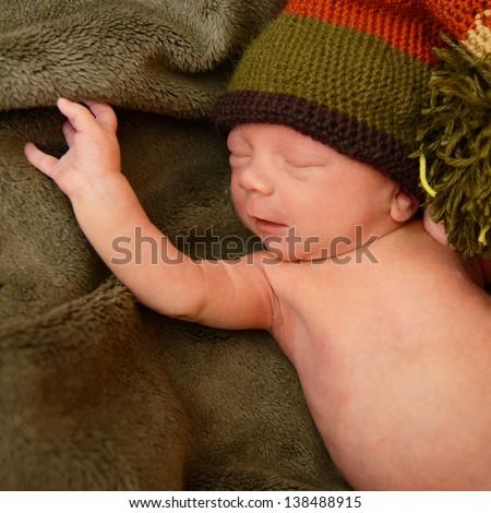 newborn baby, cute sleeping infant in green soft plaid