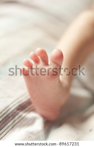 newborn baby feet closeup