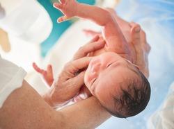 Newborn baby first bath