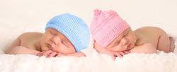 Newborn baby girl and boy twins.