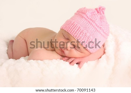 Newborn baby girl in a knitted hat