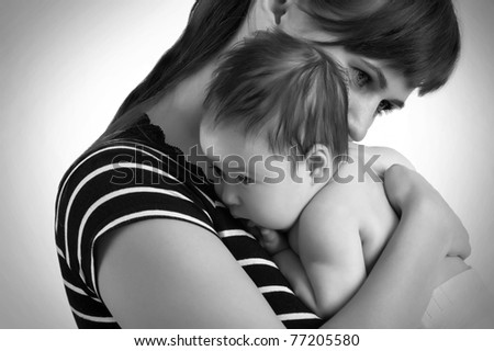 Newborn baby girl on his Mothers shoulder