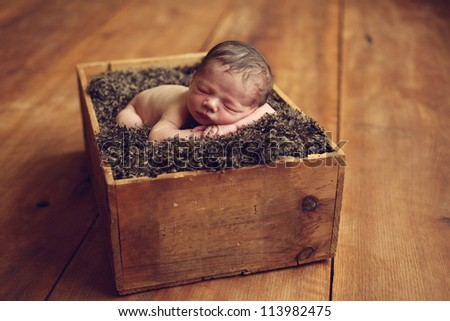 Newborn baby in a box