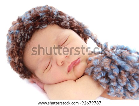Newborn baby in a hat on white background