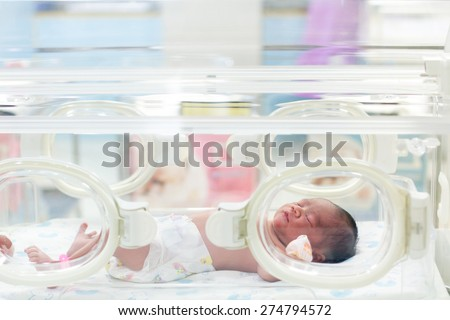 Newborn baby in hospital post delivery room