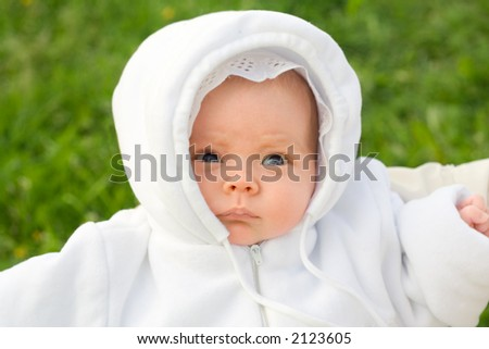 Newborn baby in park. Portrait.