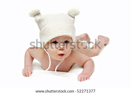 Newborn baby in the cap isolated - stock photo