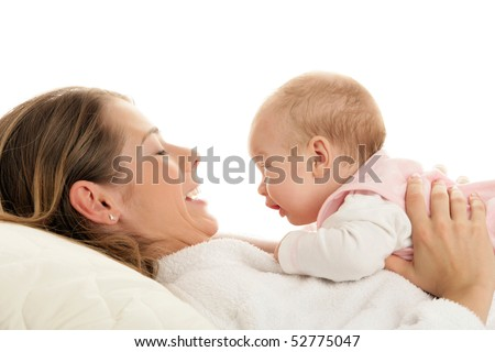 Newborn baby lying on mother's stomach