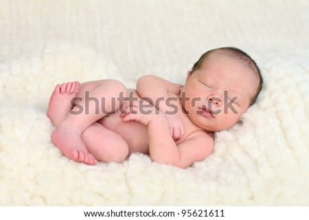 Newborn baby on sheep's wool