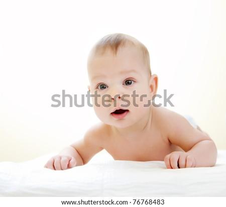Newborn baby on white towel