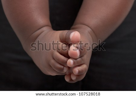 Newborn baby's feet. A closeup with a candid appeal. The baby skin is african brazilian tone.
