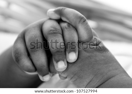 Newborn baby's hand. A closeup with a candid appeal. The baby skin is african brazilian tone.