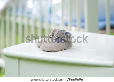 newborn baby shoes on a chair