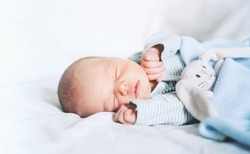 Newborn baby sleep first days of life. Cute little newborn child sleeping peacefully
