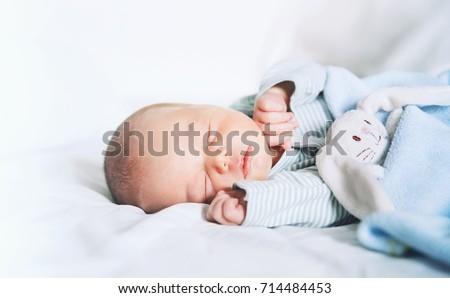 Newborn baby sleep first days of life. Cute little newborn child sleeping peacefully