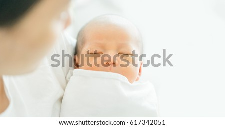 Newborn baby sleep first days of life.Mother day concept.