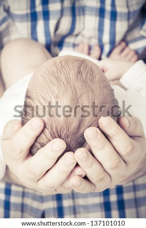 Newborn baby Sleeping on farther Hands