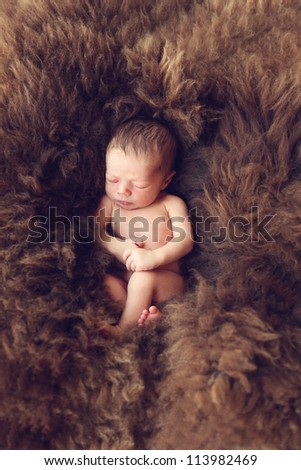 Newborn baby sleeping on Fur